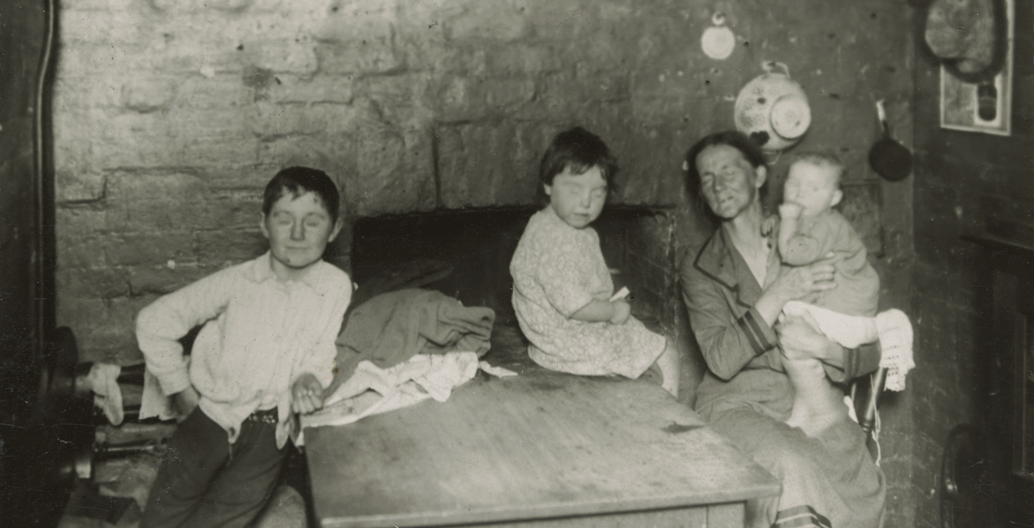 Carlton [Kitchen interior with woman and three children]. Image: SLV