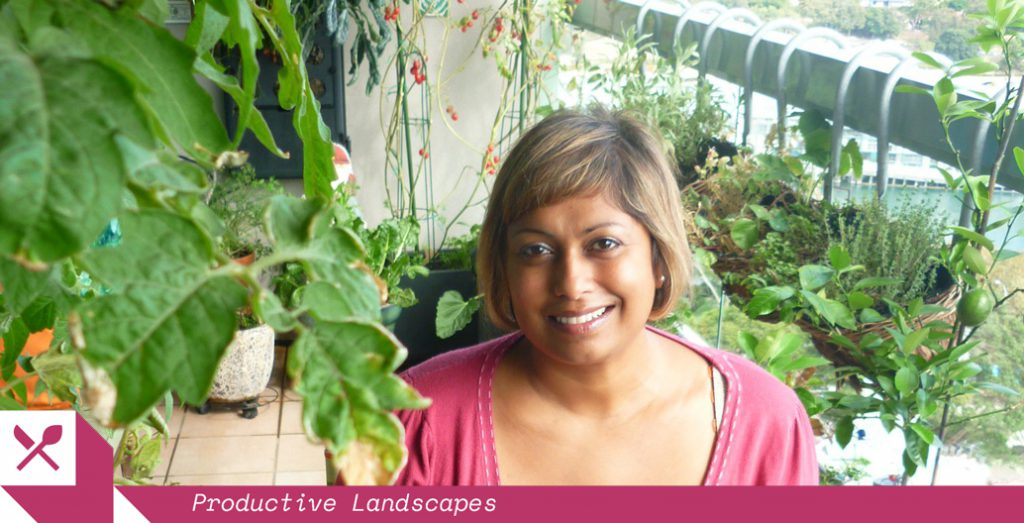 Indira Naidoo pictured in her verdant Potts Point balcony. Image: The Edible Balcony.