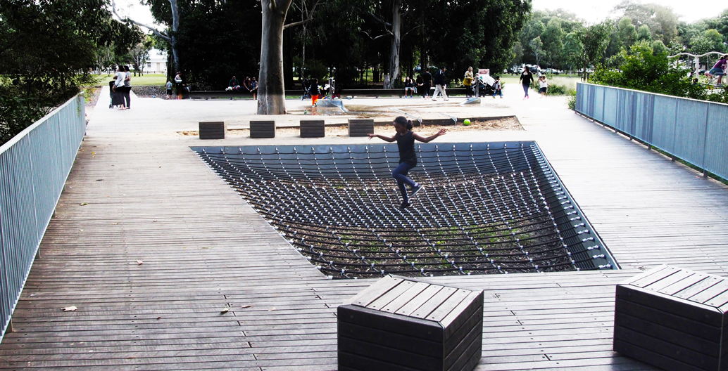 The playground's floating rope and timber seating.