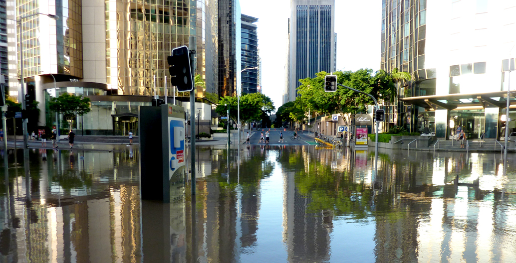 Flooded intersection of Eagle and Charlotte Streets, Brisbane. Image: BNHCRC
