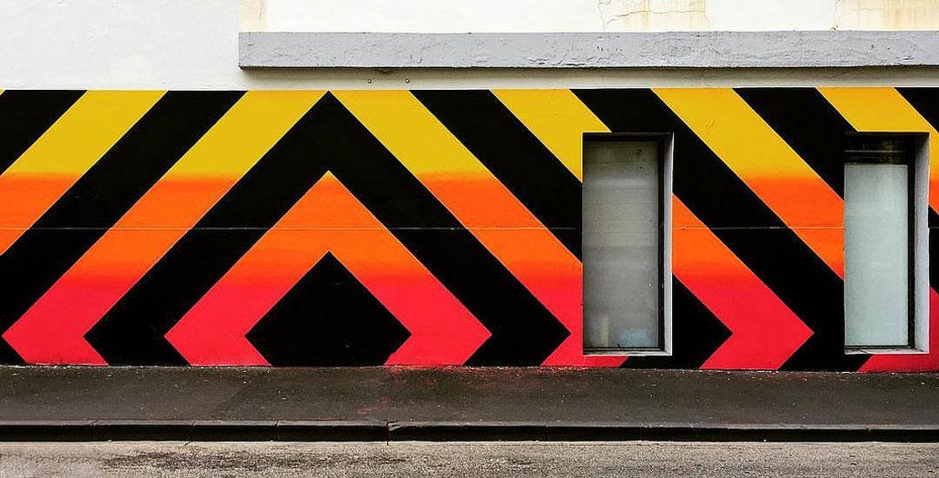 A mural of Reko Rennie's on Greville St in Prahran, Melbourne. Image: Fernando de Sousa.