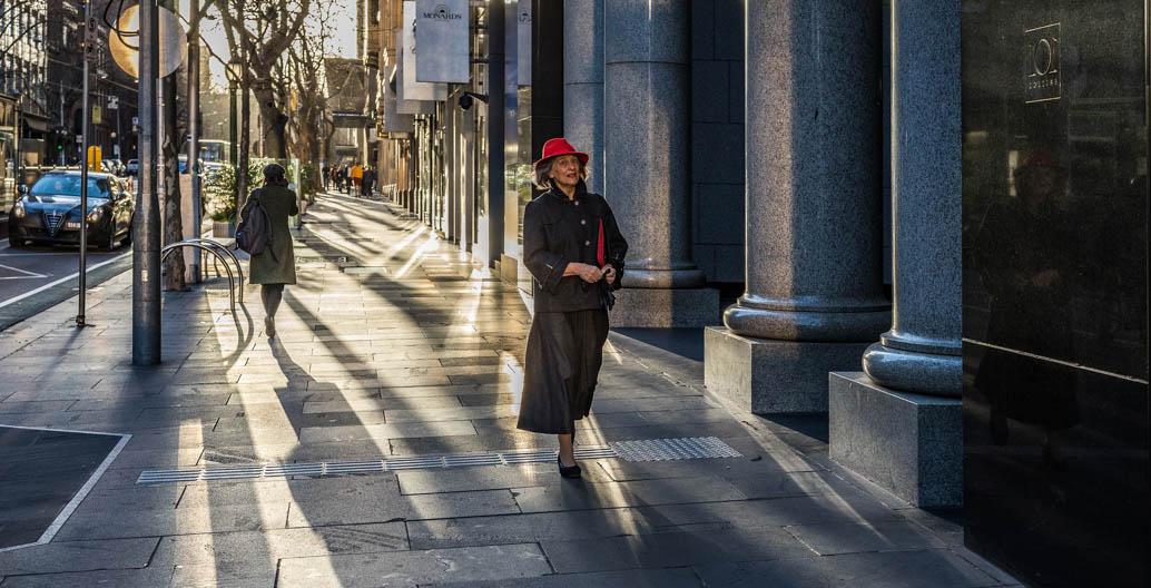 A pedestrian walks down the 'Paris' end of Melbourne's Collins St. Image: Chris Brown.