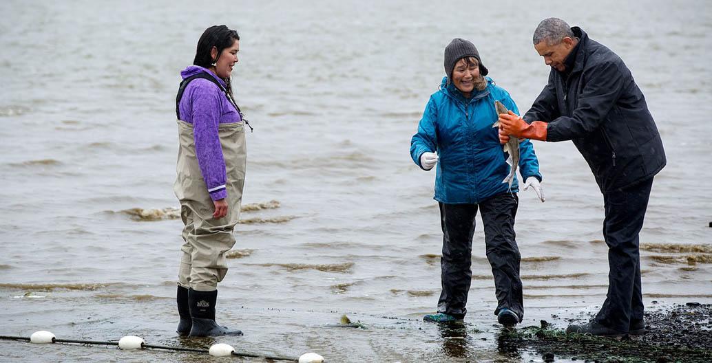 Barack Obama with salmon fisherwomen Kanakanak Beach in Bristol Bay, Alaska. Image: Obama White House Archives.