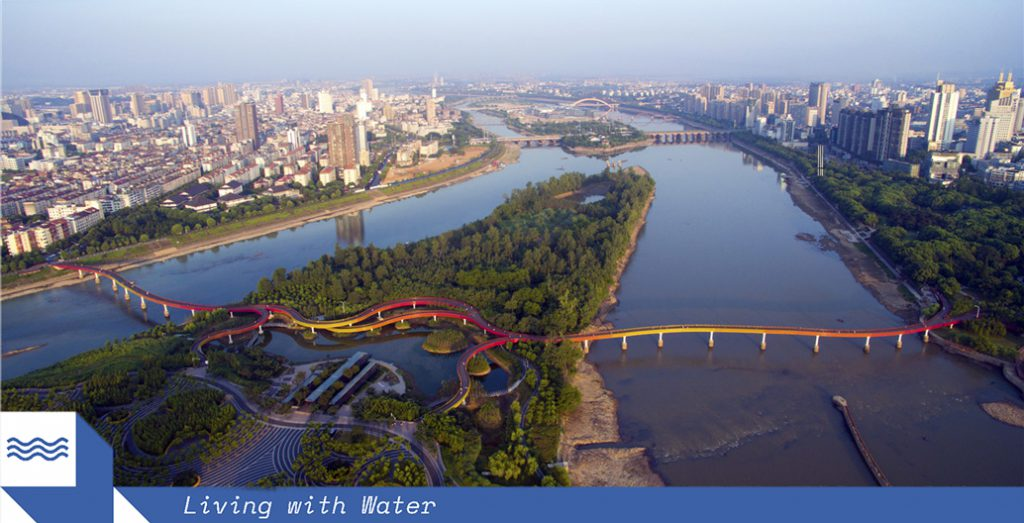 """WAF's 2015 Landscape of the Year Yanweizhou Park has given Jinua City a new cultural and community identity. The """"sparrow tail"""" wetlands, circular bioswales, 'cut and fill' terraced riverbank and entirely permeable surrounds """"make friends"""" with flooding. Image: Turenscape."""