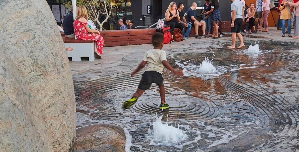 A child plays in Waterline at Yagan Square