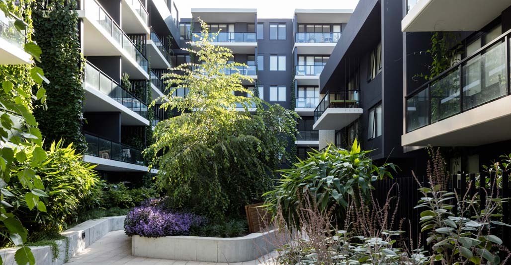 Internal courtyards embrace microclimatic conditions for a cool communal living experience. Image: Brett Boardman