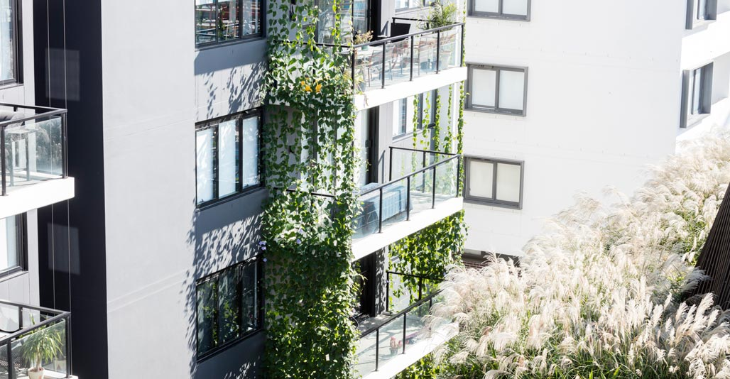 Plants tumble from balconies to add to a unified sense of green. Image: Brett Boardman