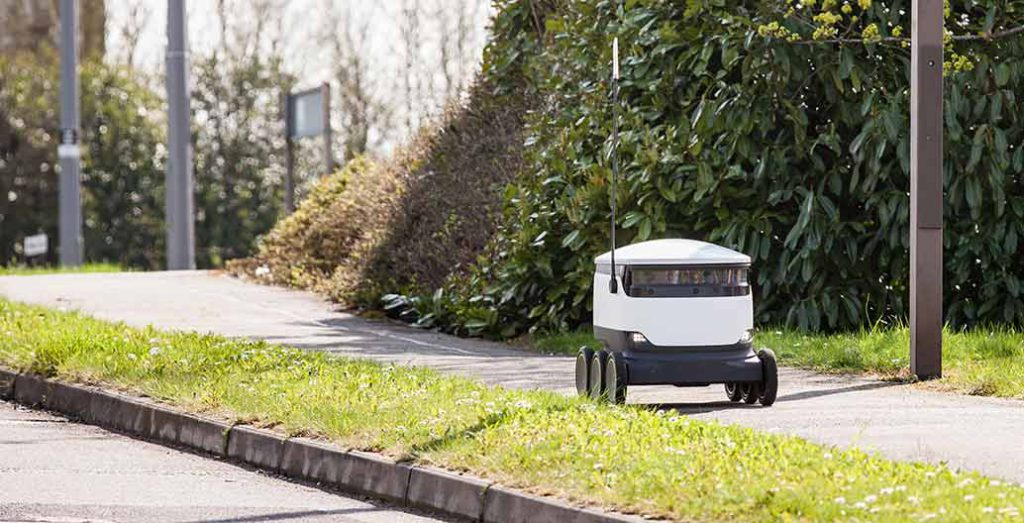 A Starship robot delivery unit on the footpath.