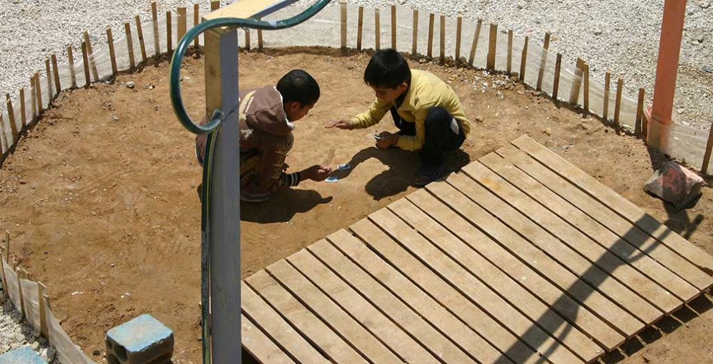 A playground, however informal and temporary, is immediately put to good use.