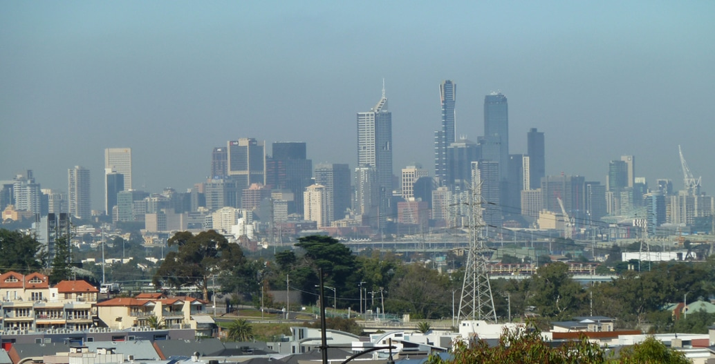 Temperature inversion regularly traps air pollution over Melbourne, visible as a smog haze. Photo: Anne Beaumont