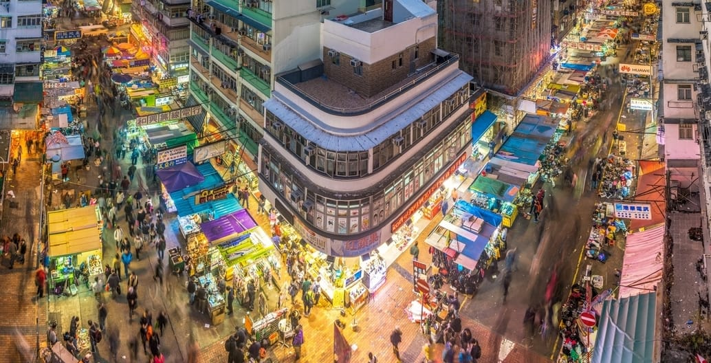 Road infrastructure can serve vibrant urban streetlife. Hong Kong. Photo: Steven Wei