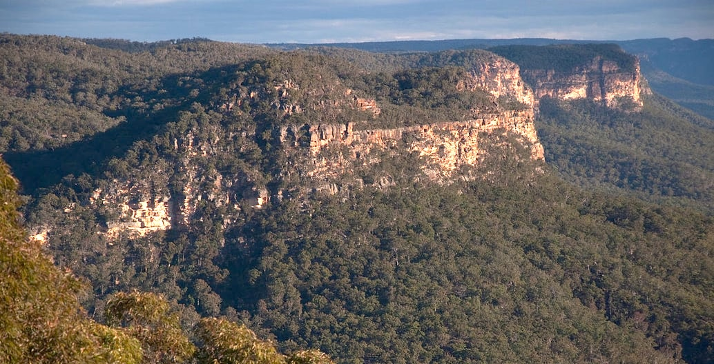 Towering sandstone escarpments above the Burragorang valley in the World Heritage listed Blue Mountains, NSW. Photo: popejon2