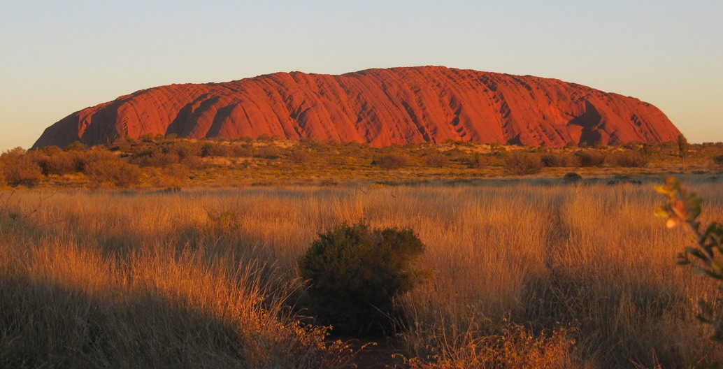 "Uluru is an inselberg, literally ""island mountain"" dominantly composed of arkose, a coarse-grained type of sandstone. It has great cultural significance for the Aṉangu people. Photo: Melissa Nursey-Bray"