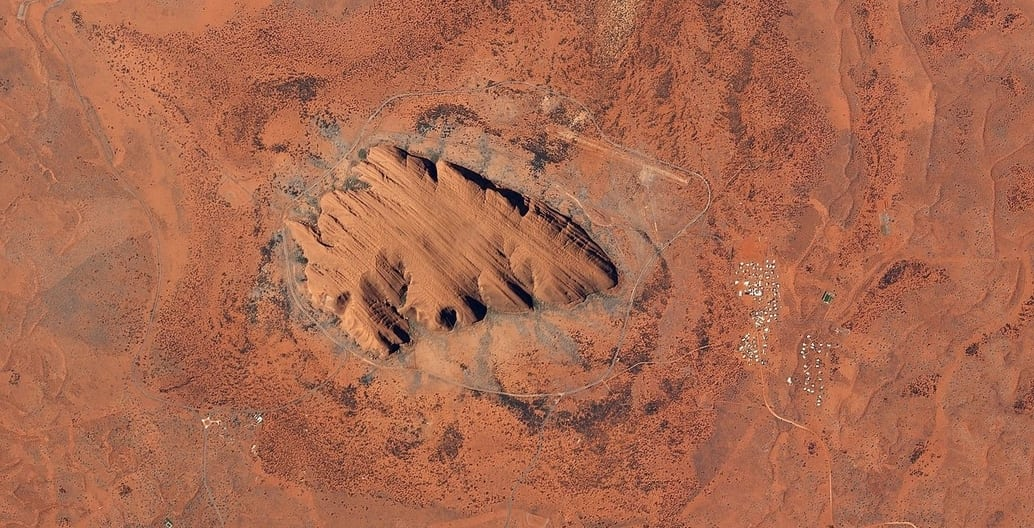 Uluru from above. It has a total circumference of 9.4km. Photo: Planet Lab