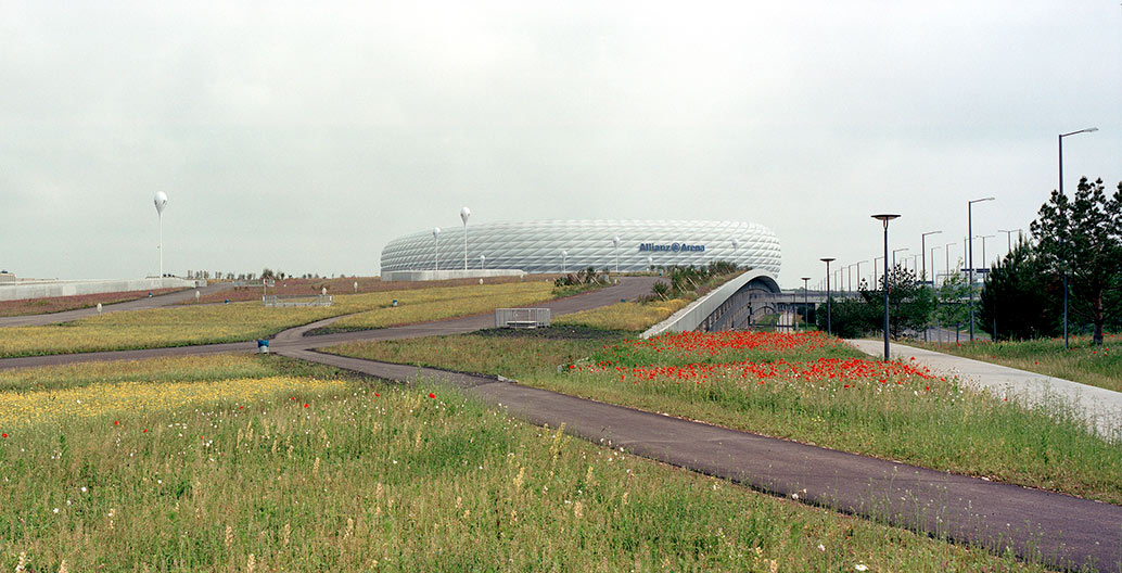 Allianz Arena, Munich. This hybrid combination landscape-park is not only a platform for the stadium building but also a reassessment of today's definition of a park. Photo: Christian Vogt