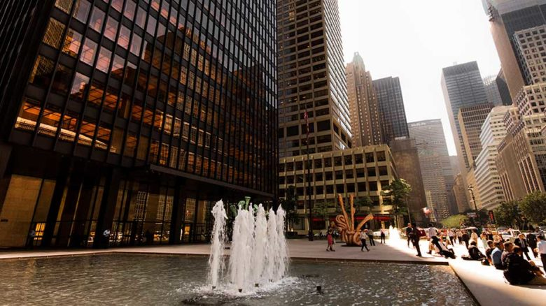 The forecourt of the Seagrams Building - the quintessential privately-owned public space. Image: Alex Schwab (cropped)