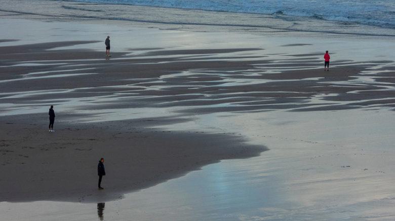 Social distancing, seen here on a British beach, has not been taken seriously by enough Australians. Image: Nick Fewings.