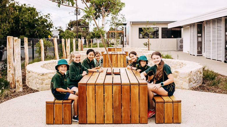 Students at Paringa Park Primary School sit at a kid-sized table. Image: Jason Tyndall
