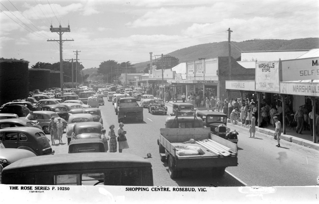 Shoppers enjoying the ample, loosely regulated parking of Rosebud, c.1940. Image: Rose Stereograph Co. (SLV collection)