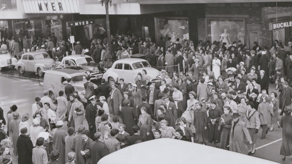 Shoppers in Melbourne's Bourke Street battle with cars for street space, c.1948. Image: State Library of Victoria archives